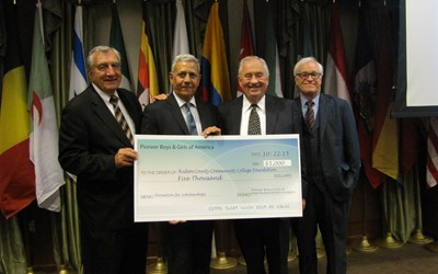 From l., are Joseph Sansone, HCCC vice president for development; Jose Torres, president of Pioneer Boys & Girls; Kenneth Lindenfelser Sr., fundraising chairman; and Glen Gabert, president of HCCC.