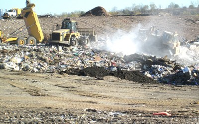Photo by Ron Leir Compactors and bulldozers operated by a contractor hired by the NJSEA level out wastes unloaded at Keegan Landfi ll in Kearny.