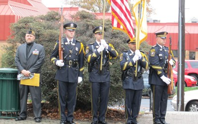 Photo by Ron Leir American Legion Frobisher Post Commander Keith McMillan (l.) and the Kearny Police Department Honor Guard in formation at Kearny Veterans Day ceremonies.