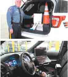 Photos by Ron Leir TOP: Dep. Police Chief George King displays some of the emergency supplies kept in trunks of new police SUVs. BOTTOM: A view of the SUV's interior shows MDT on passenger side.