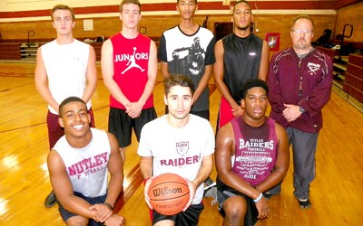 Photoo by Jim Hague The Nutley High School boys' basketball team features a host of talented seniors who were eager to institute a new defensive philosophy. Kneeling, from l., are Devin Merritt, Geoffrey Bevere and Devin White. Back row, from l., are Julian Chiarieri, Billy Montgomery, Antonio Olivo and head coach Bob Harbison.