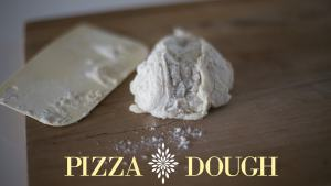 Dough on cutting board sprinkled with flour