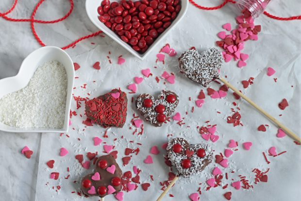 Chocolate Covered Apple Hearts with candies, coconut and sprinkles