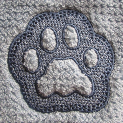 Embossed Paw Print Machine Embroidery Design by Erich Campbell