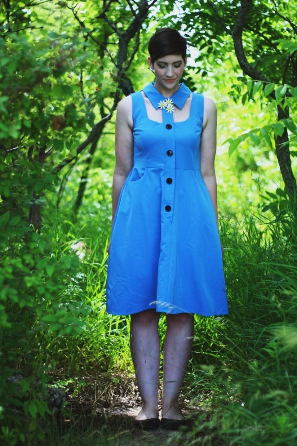 Mod outfit of the day. Cherry Velvet collared dress, vintage daisy broach, Twiggy-esque hair and makeup.