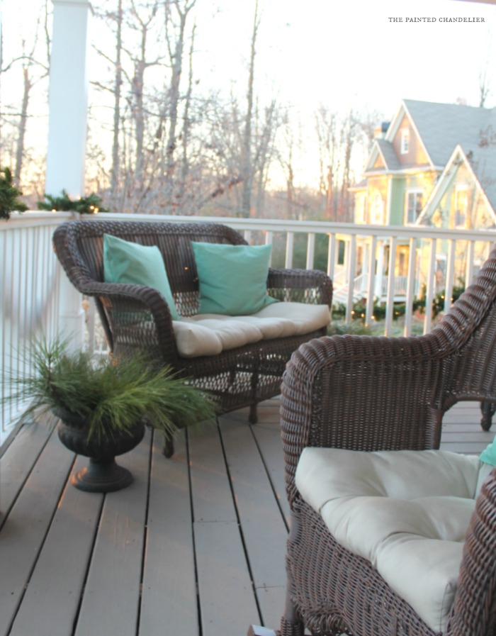 porch-loveseat-pine-lights-christmas-porch