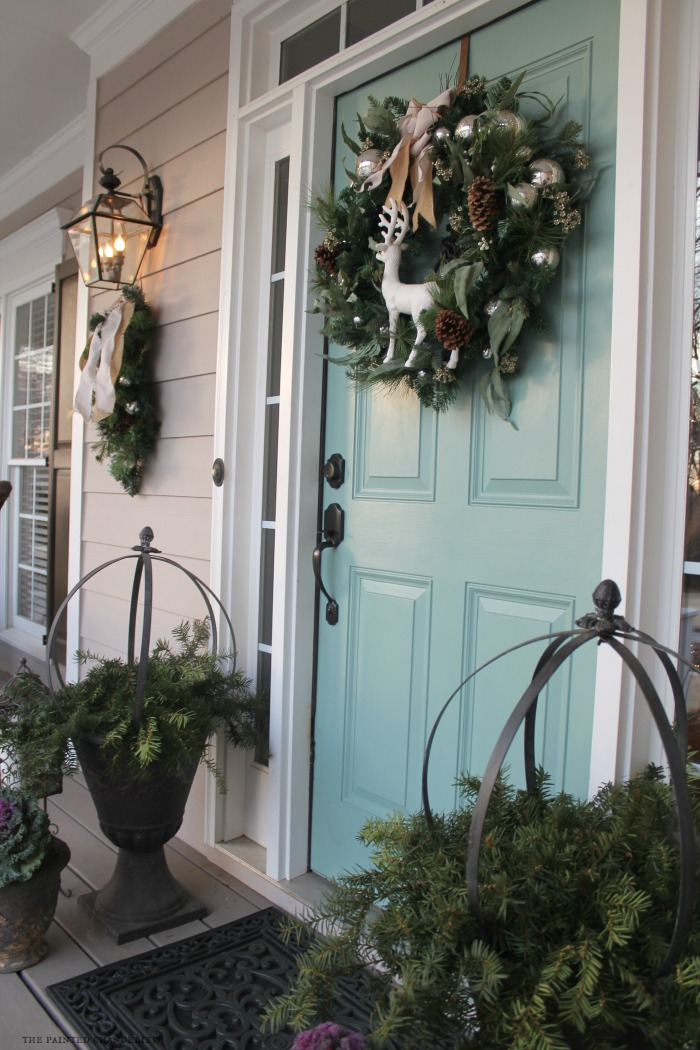 side-view-front-door-lights-wreath-greenery-christmas-porch