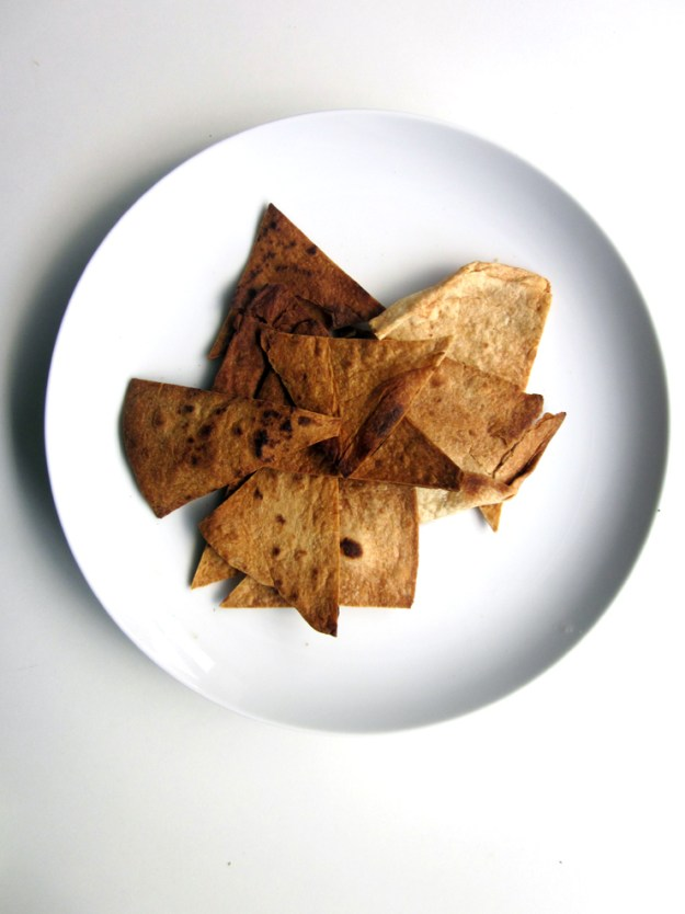 Homemade chips are the only way to go with this guac of insane greatness. Or store-bought.