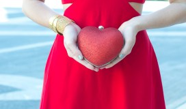 red glitter heart-shape clutch
