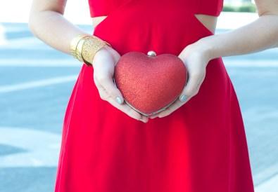 red glitter heart-shape clutch