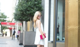 white dress pink clutch