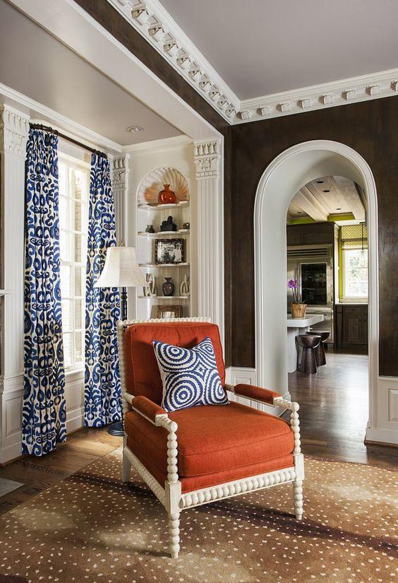 antelope-rug-orange-chair-blue-curtain
