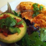Spicy Tilapia and Stuffed Avocado on Spring Greens