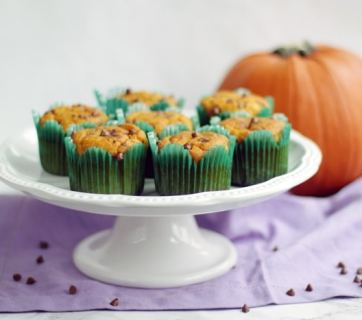 Pumpkin Chocolate Chip Muffins - Moist and tender, with a delicate pumpkin flavor and studded with chocolate chips. These muffins are low fat, low sugar and make a great breakfast or quick dessert. Recipe from The Petite Cook