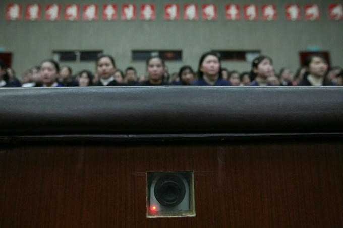 A camera in the wall, used to film inside an auditorium at the Mangyongdae Schoolchildren's Palace in Pyongyang, North Korea, records as children wait for a performance to begin Wednesday, Feb. 27, 2008.