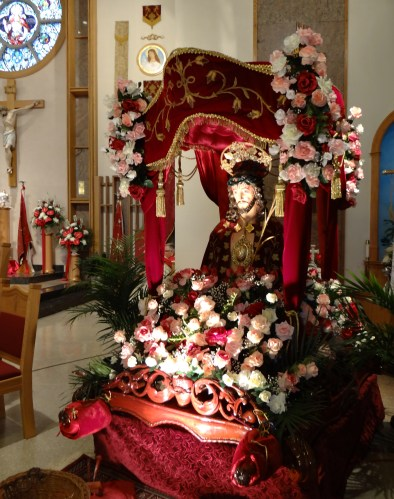 After the procession, statues are placed in the church to decorate for the mass.