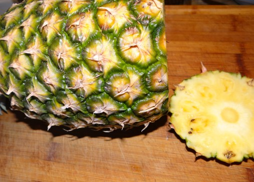 Start by preparing your fruit... First up is the pineapple.  I'll take you through how to easily slice up a pineapple, but if you don't have one available, you could used canned or frozen pineapple chunks.