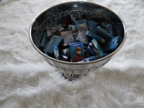"The bowl filled with fun ""Frozen"" themed chocolates."