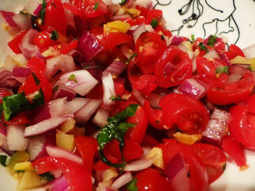 And here you have it, fresh Pico de Gallo. Cover with plastic wrap and let sit until it's time to top your plate.