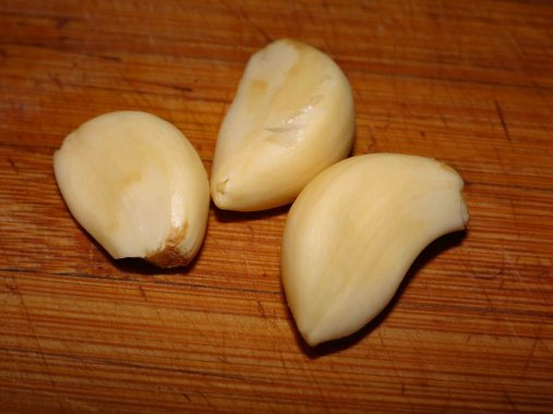 Three cloves of garlic... please use fresh here, it makes a difference as there are only 4 ingredients and two seasonings.