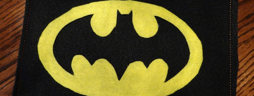 Secure the Batman symbol onto the fabric and press firmly.