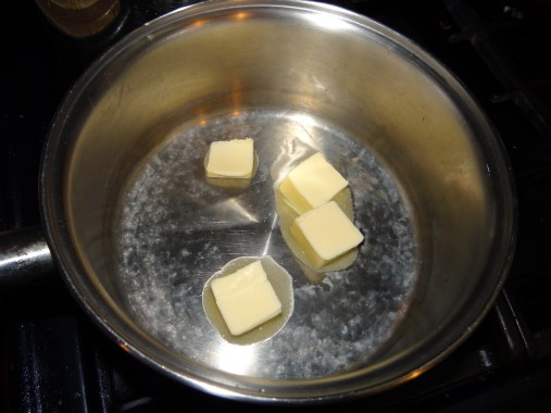 In a large sauce pan add in 4 Tbs. of butter. You want to set your burner to med/low.