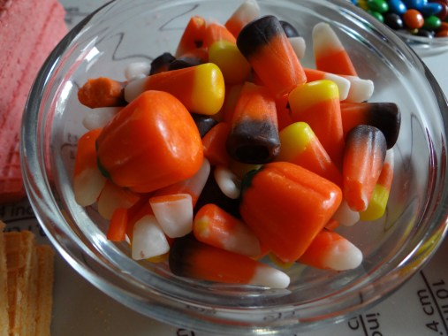 Candy corn is a non-negotiable if you are making these for Halloween! Even if they are just on a few, it really helps to doll them up... Now, if you are making these for let's say Christmas or Easter, you might use candy canes or peeps!