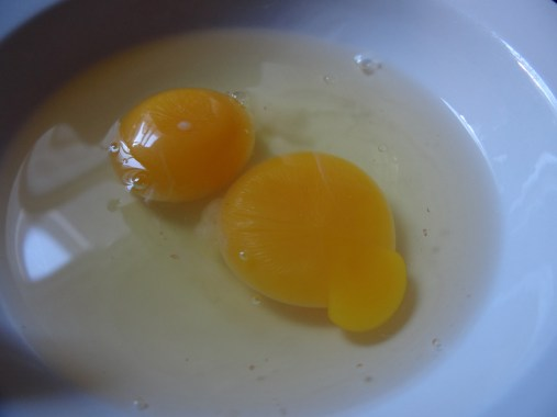 Place two eggs in a bowl.