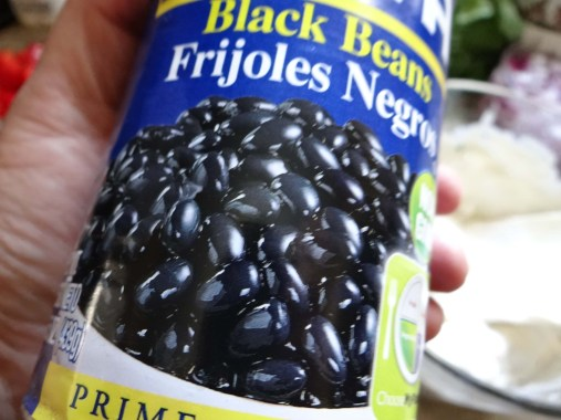 Rinse out a can of black beans.