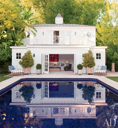 Photo of pool and poolhouse via AD
