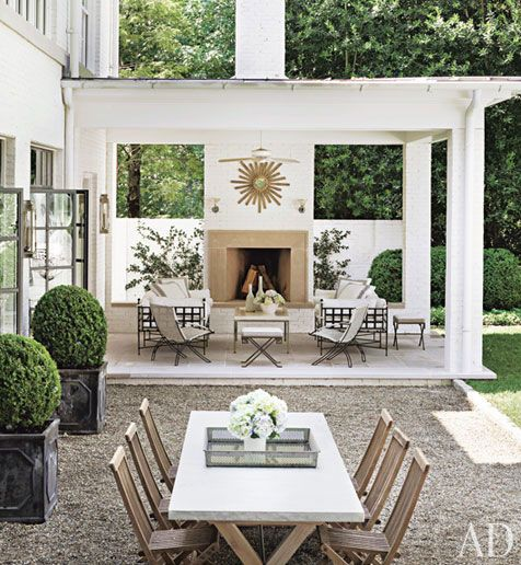 White Home with Porch and Boxwoods