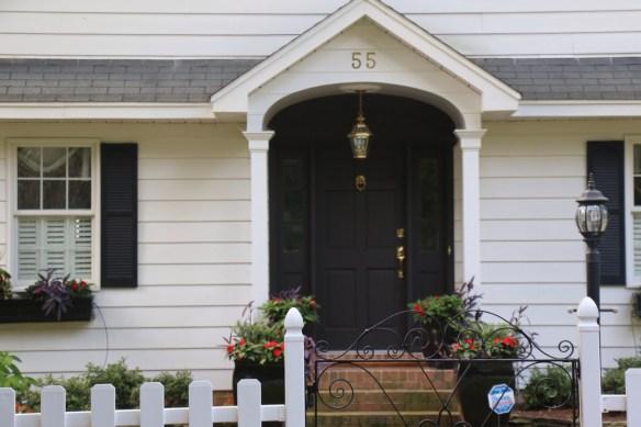 Black front door with window boxes