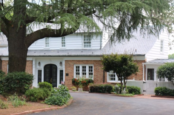 Brick home with black glass front door