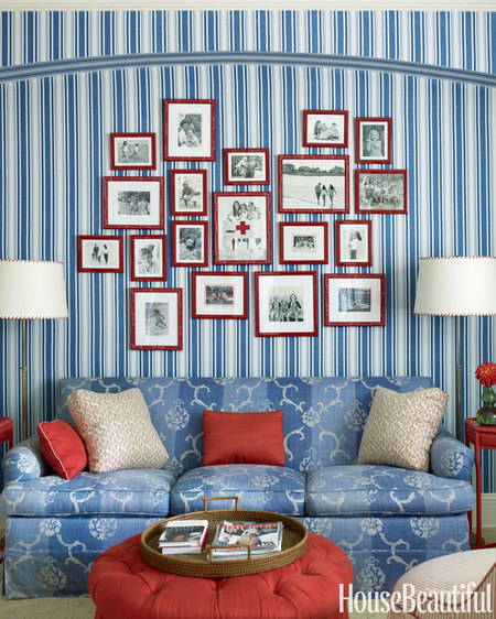 Gallery Wall with red flames and blue wallpaper via HB