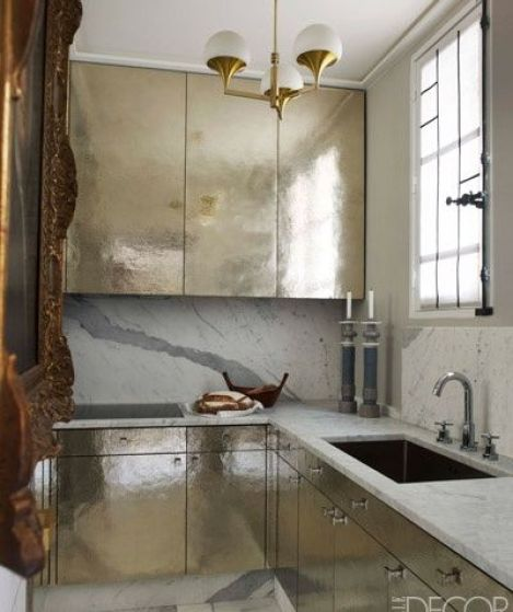 Silvery gold hammered cabinets in the Parisian apartment of Jean Louis