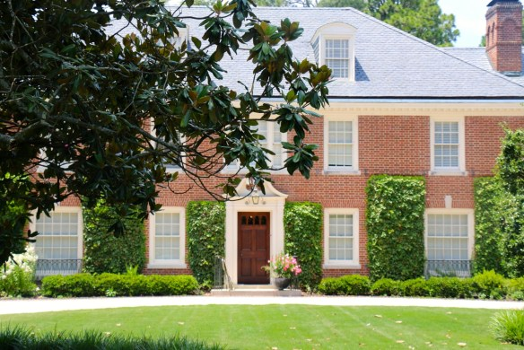 Red brick home with ivy on the house