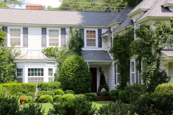 White home with lush lanscaping in Pinehurst