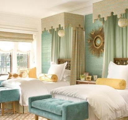 Stylish Twin Beds with blue, green, and yellow