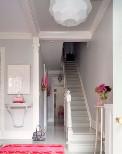 Pops of pink in this narrow hallway by Suellen Gregory via Mix and Chic