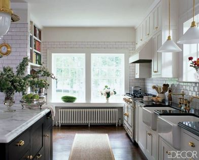 Subway tile by Urban Archaeology in kitchen via Elle Decor