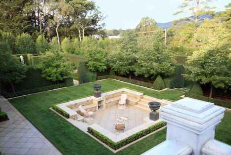 Sunken patio with incredible hedging by Paul Bangay