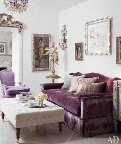 Ottoman with purple velvet sofa via AD