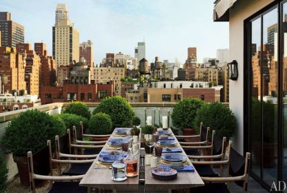 Terrace designed by Nathalie Grenon for holly hunt at Angus Wilkie and Len Moran's NYC home via AD
