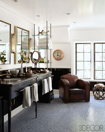 A leather chair in a bathroom via Elle Decor