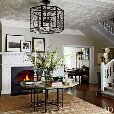 Fireplace in the entry of Net-a-porter founders London home via AD