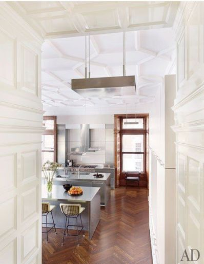 Rich herringbone hardwood floors via AD