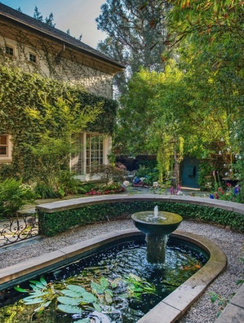 Fountain of LA home of Jennifer Lawrence via Lonny