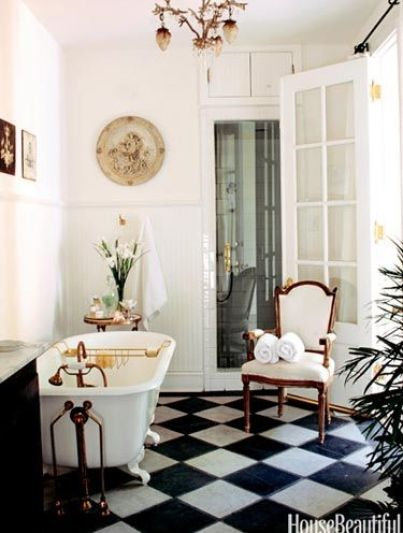 Checkerboard floors in a charming bathroom via House Beautiful