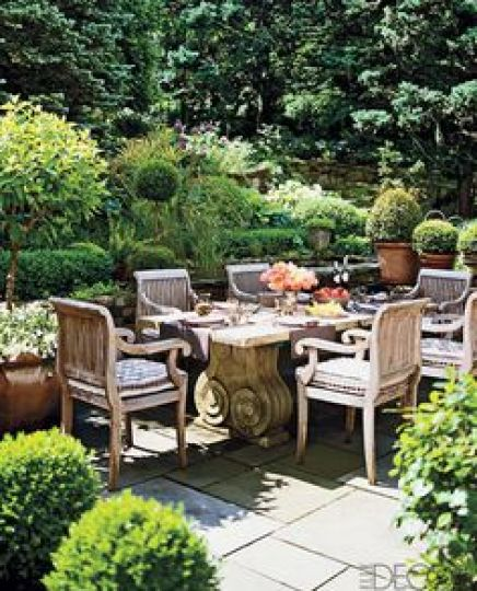 Lovely outdoor  Spring dining full of potted boxwood