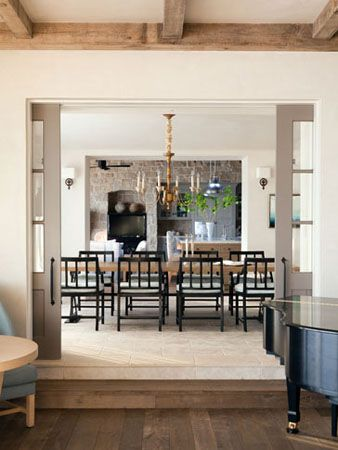 Large Pocket Doors Transition The Spaces In This Home With A Very Open Floor Plan Posted Architecture Dining Rooms